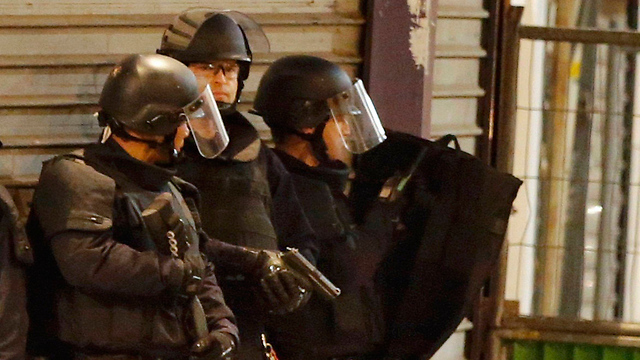 Police at the scene of the raid in northern Paris. (Photo: Reuters)