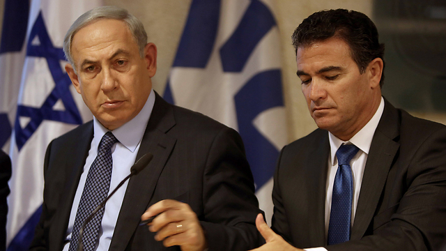 Cohen and Netanyahu. A master in interpersonal relations, he won the prime minister's trust, but did get into arguments with other important players such as senior Shin Bet and IDF officials and some politicians (Photo: AFP)