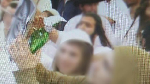 Guests stabbing photo of slain Palestinian baby