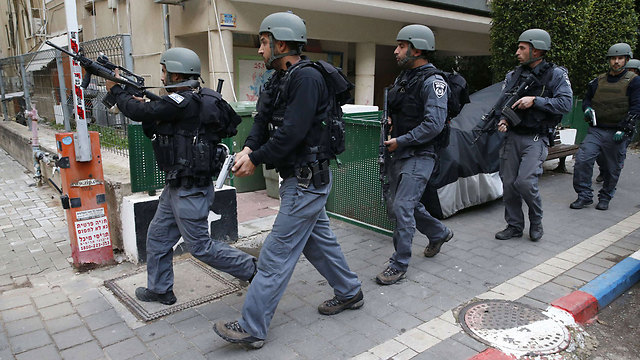 Police searching for the suspected shooter following an attack in central Tel Aviv that killed two and wounded several others (Photo: AFP)