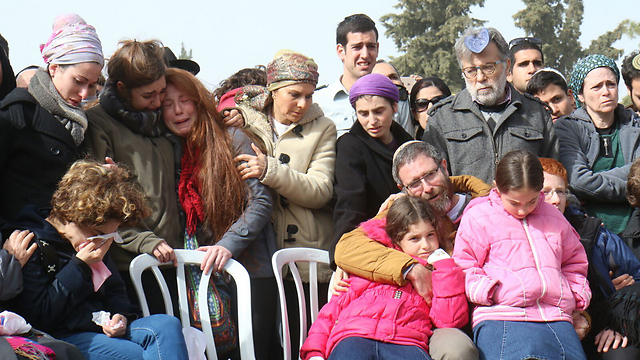 The grieving family at the funeral (Photo: TPS)