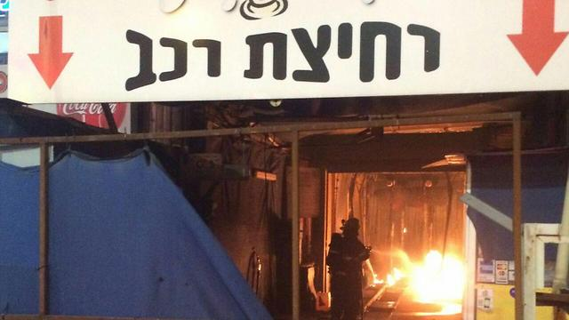 Price tag? A carwash in Petah Tikva was set on fire with anti-Arab graffiti sprayed on the wall (Photo: Fire Department and Hatzalah Petah Tikva)