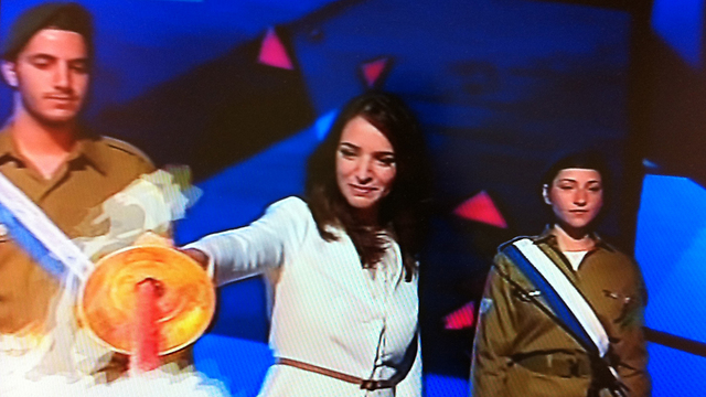 A proud Muslim. Aharish lights at torch at the 2015 Independence Day ceremony