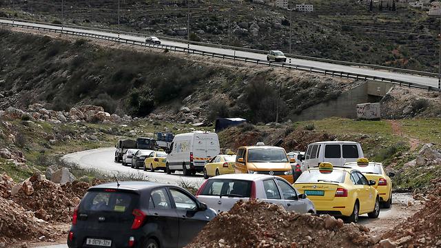 A long line of cars waiting to enter Ramallah (Photo: AFP)