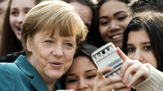 German Chancellor Angela Merkel with refugees in Berlin (Photo: AFP)