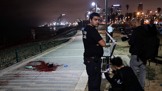 Pool of blood on the Jaffa boardwalk (Photo: AFP)