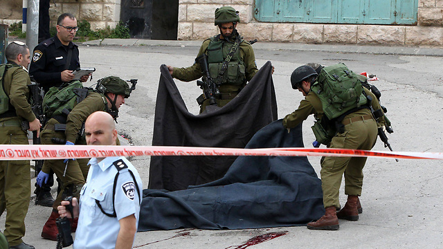 Removal of the terrorist from Hebron (Photo: AFP)