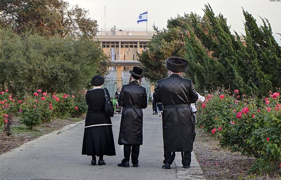 An ultra-Orthodox party stands before the Israeli flag (Photo: Sharon Gabay)