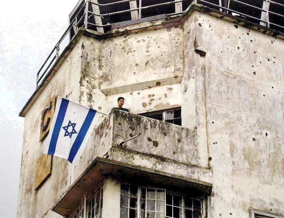 The control tower at the old terminal, still carrying the marks left by the bullets of the Israeli commandos (Photo: Elad Gershgoren)