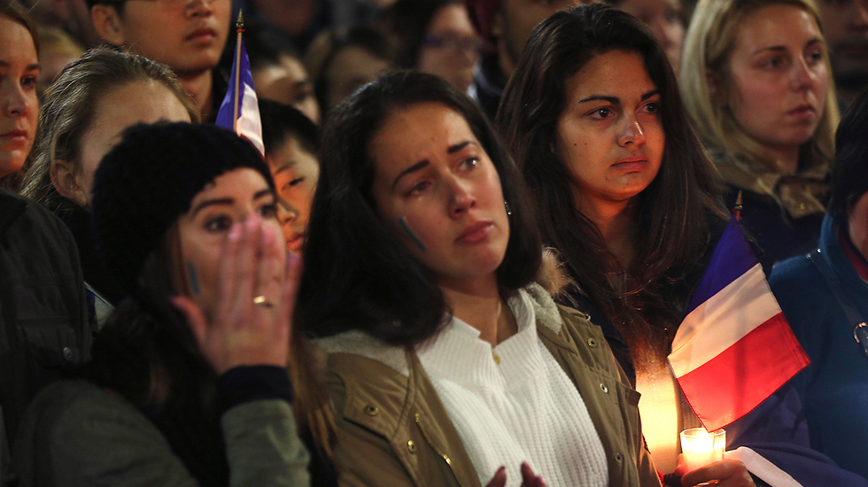 A crowd gathers to mourn the attack (Photo: Associated Press)