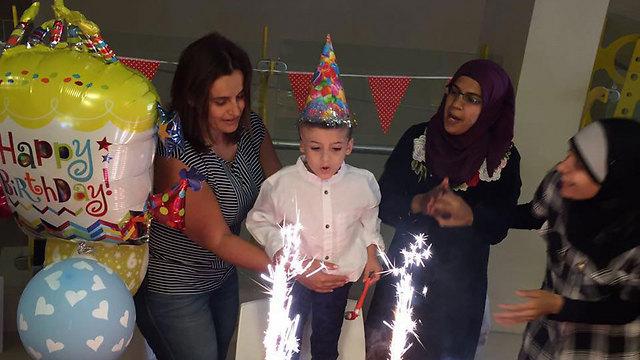 Ahmed Dawabshe celebrates his sixth birthday