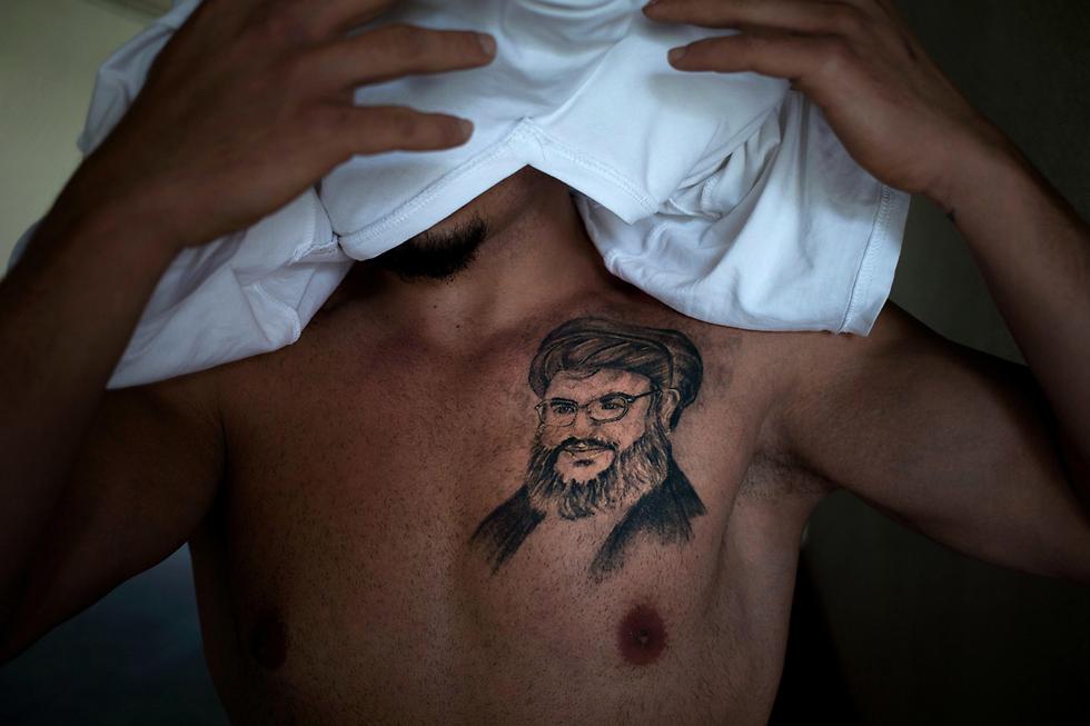 Tayseer's Nasrallah tattoo (Photo: AP)