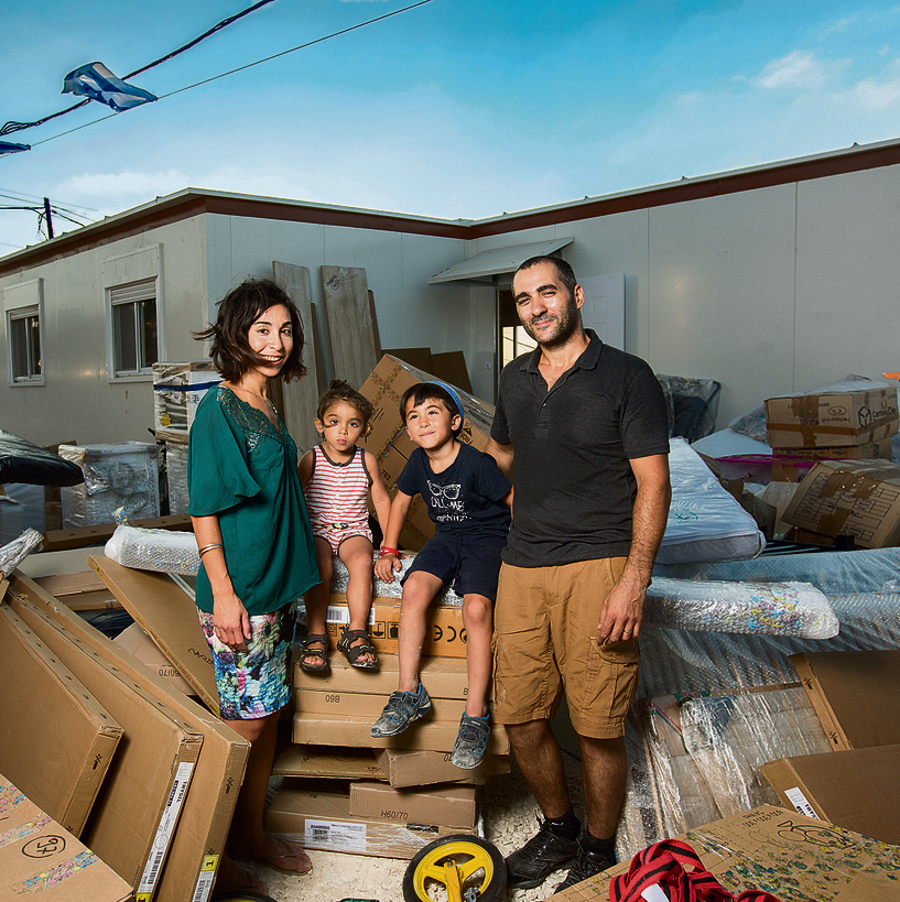 Sarah and Stephane Zaafran with their two children in their new home in Brukhin (Photo: Tal Shahar)