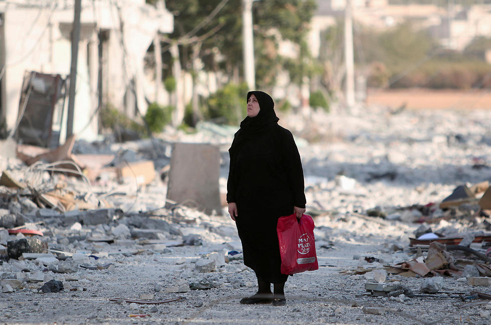 A Manbij resident walking through the city (Photo: Reuters)