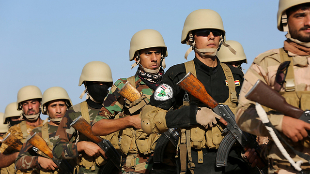 ISIS militants marching (Photo: Reuters)