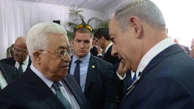 Prime Minister Netanyahu with PA President Mahmoud Abbas (Photo: Amos Ben Gershom/GPO)