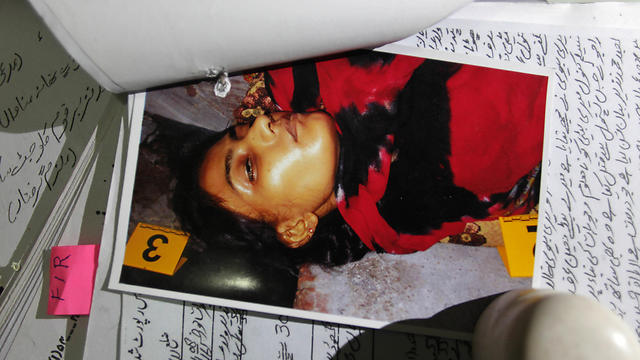A  picture of Tasleem, who was shot by her brother, is seen with records at police headquarters in Lahore (Photo: AP)