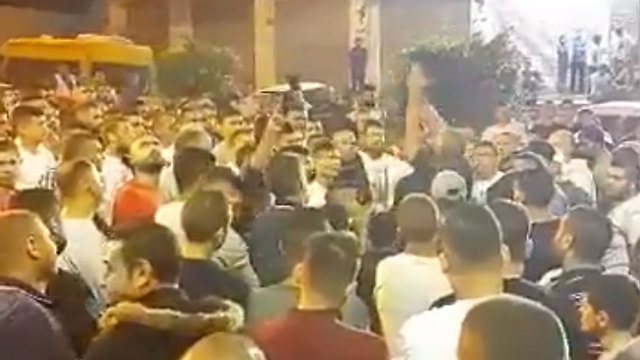 Celebrations outside the terrorist's home in the Village of al-Ram.