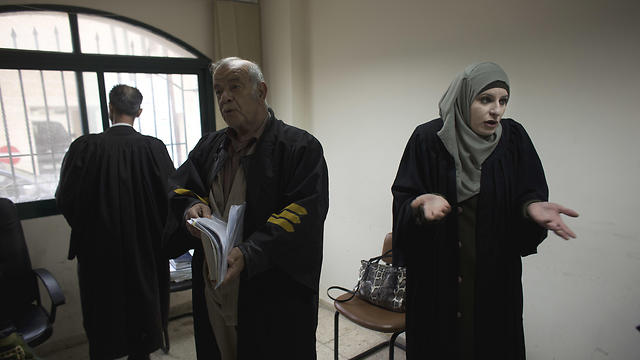 Reema Shamashneh (R) speaks with her colleagues during a break at the Islamic family court in Ramallah (Photo: AP)