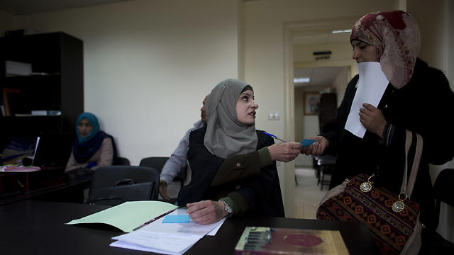 Reema Shamashneh talks to her client in the Islamic family court in Ramallah (Photo: AP)
