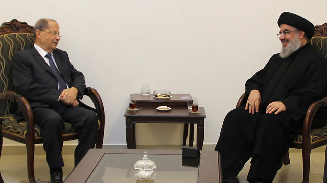 Lebanese President Michel Aoun with Hezbollah Secretary-General Hassan Nasrallah, 'Lebanon's defender against Israel' (Photo: AP)