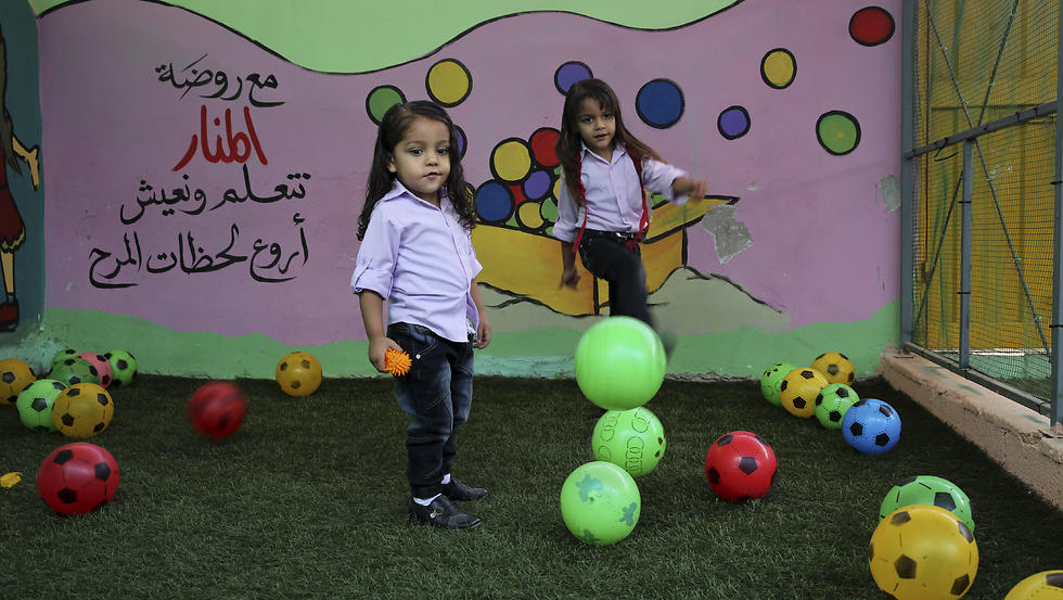 Abdel Ghani al-Attar, right, and his brother Esam, play at a kindergarten not far from their family house in Rafah (Photo: AP)