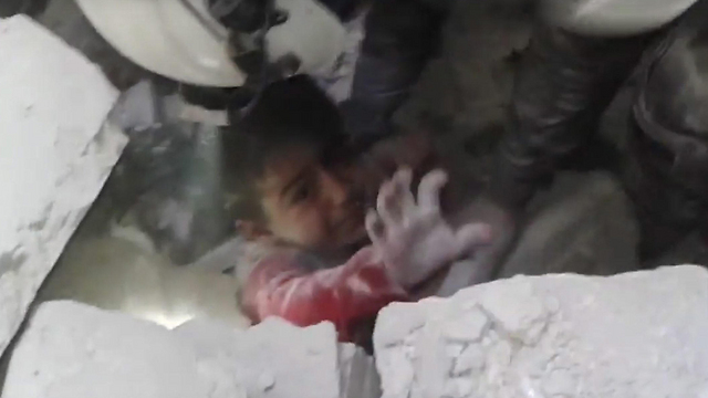A child being pulled out of the rubble in Aleppo (Photo: EPA)