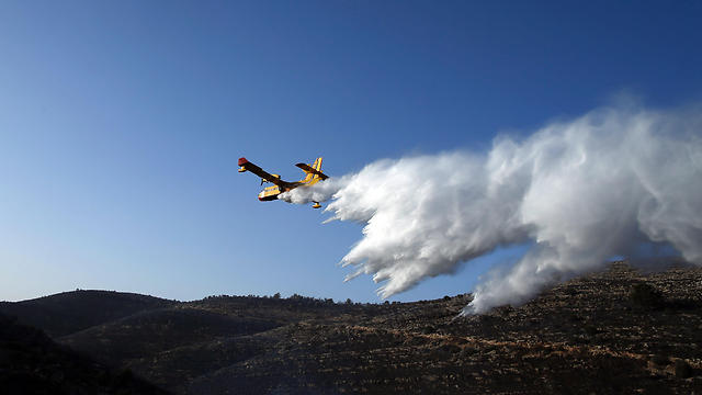 Plane in Nataf area (Photo: AFP)