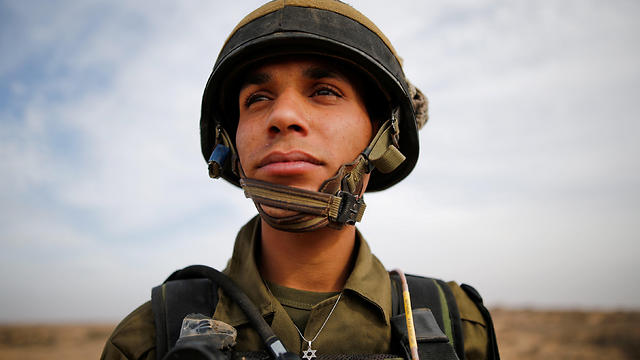 Sgt. Yusef Salutta stands in an IDF uniform wearing a Star of David (Photo: Reuters)