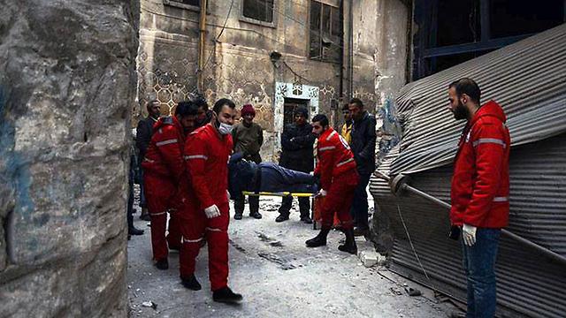 Injured in Aleppo (Photo: AP)