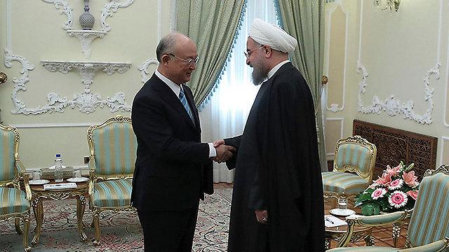 IAEA chief Amano meets with Iranian President Rouhani (Photo: AP)