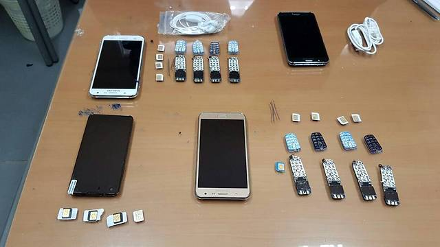 Some of the phones Ghattas was caught smuggling into prison.