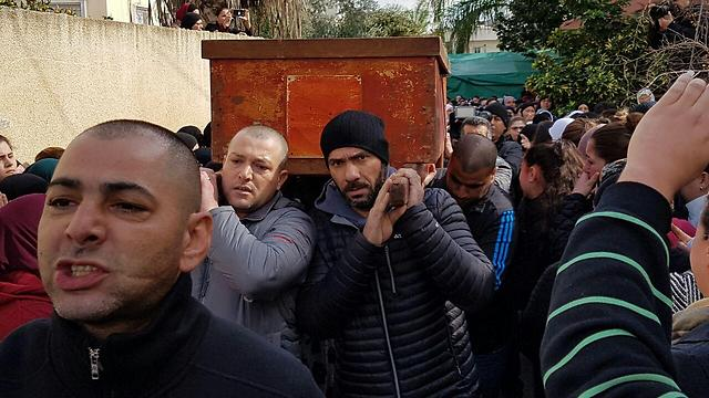 Coffin of Layan Nasser brought to a cemetery in Tira