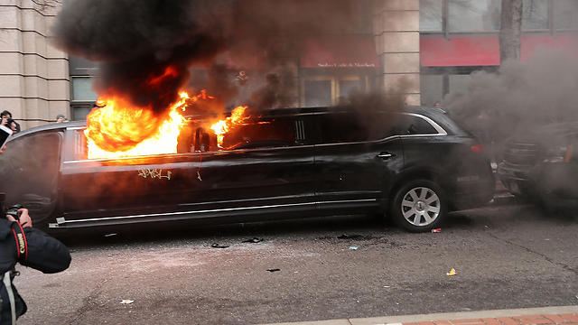Burning a limo in DC (Photo: AFP)