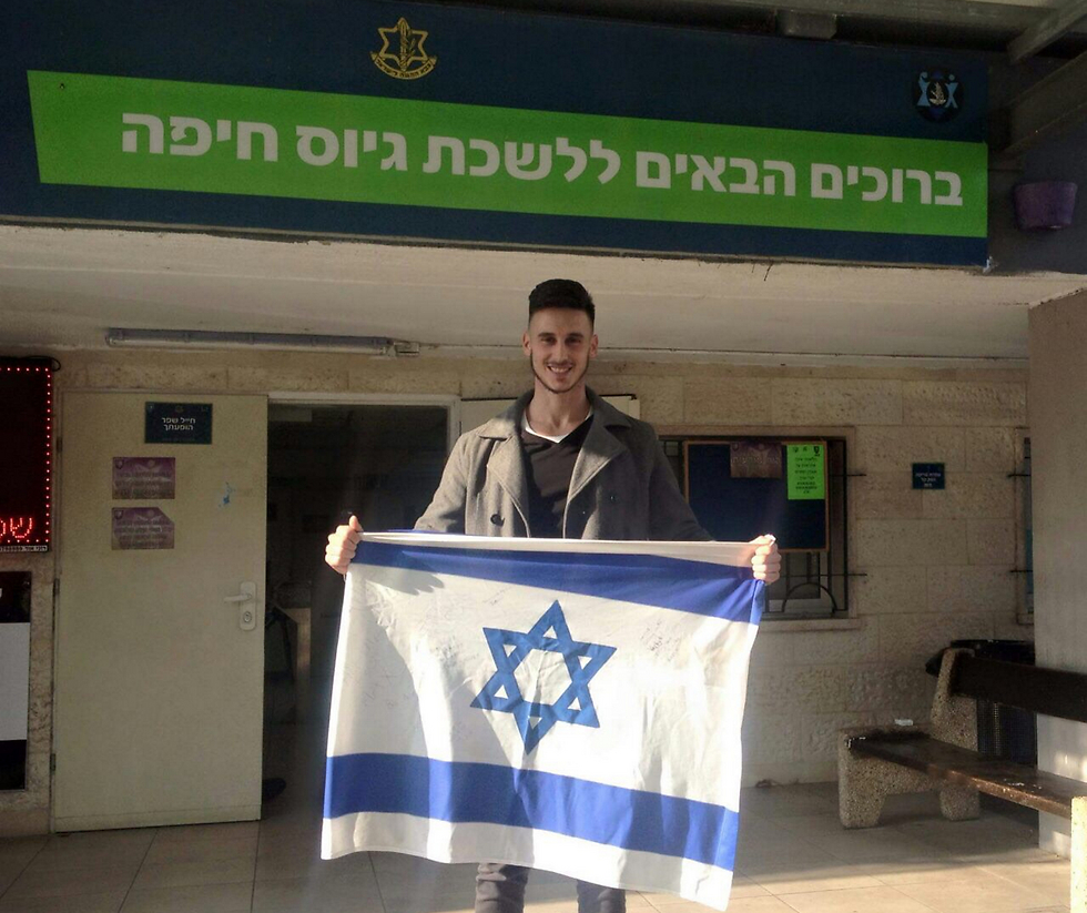 Hirshfield outside the Haifa enlistment office showing his colors