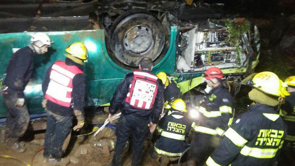 The upturned bus (Photo: Judea and Samaria Fire Fighting and Rescue Unit)