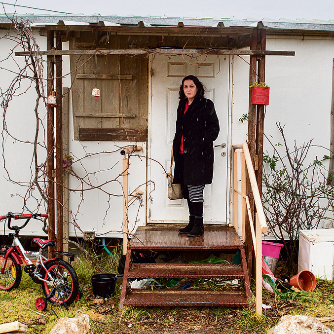 Yifat Erlich at the entrance to the caravan she used to live in. 'Pioneers don't break down. They always get up and climb the mountain again' (Photo: Yoav Dudkevitch)