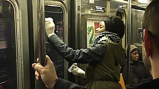 Fellow passengers help wipe away the hate (Photo: Gregory Locke) (Photo: Gregory Locke)