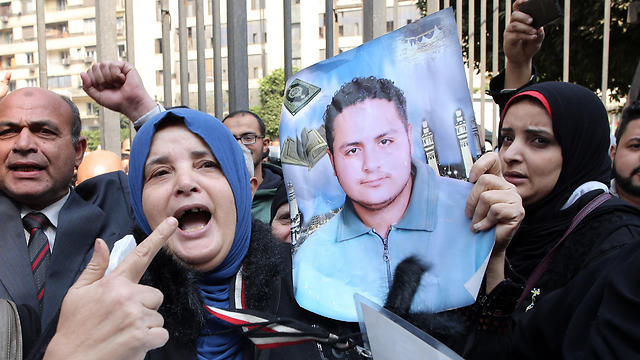 Relatives of victims killed in a riot following a football match in Port Said in February 2012, react outside the courthouse in Cairo, Egypt (Photo: EPA)