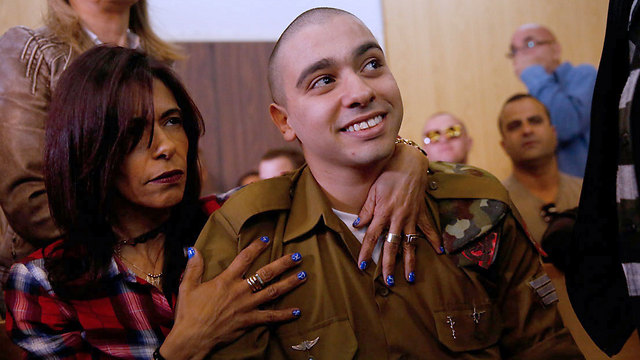 Elor Azaria with his mother. 'I assume some of the emotional outbursts were staged' (Photo: Tomer Appelbaum)