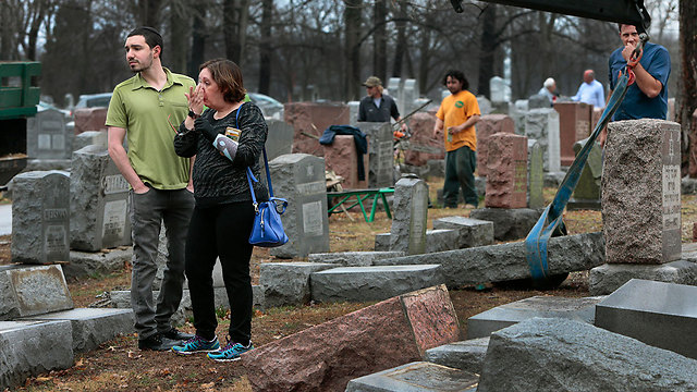 Sally Amon and her son Max at the Jewish cemetery in Saint Louis, Missouri (Photo: AP)