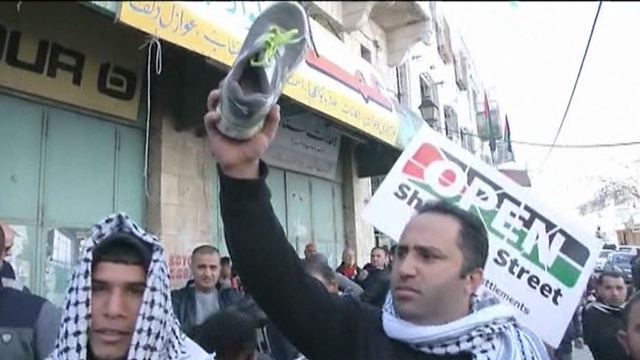 Issa Amr speaking at Hebron protest (Photo: Reuters)