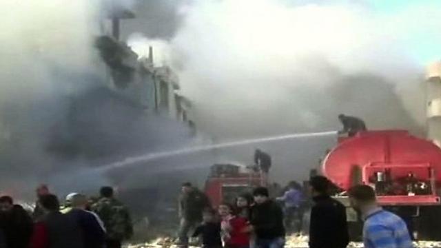 Photo: AFP, Al Ekhbariya Al Soriyah TV