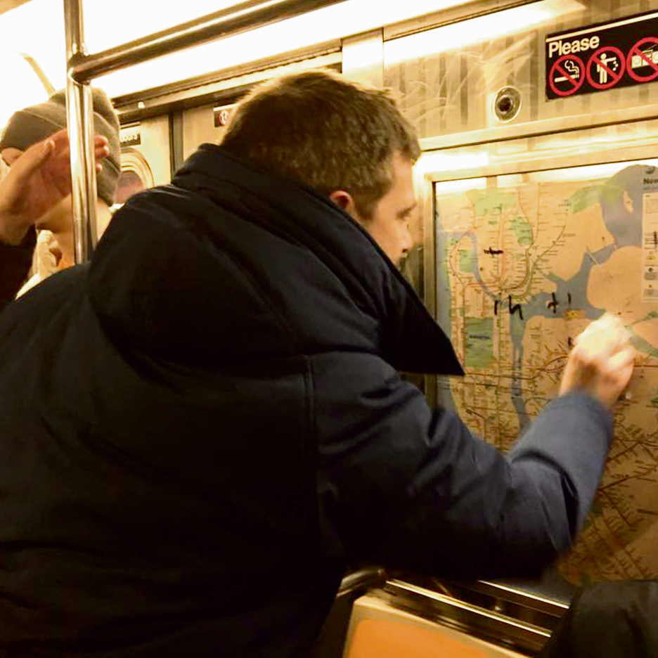 Erasing anti-Semitic graffiti on the NY subway train (Photo: Gregory Locke)