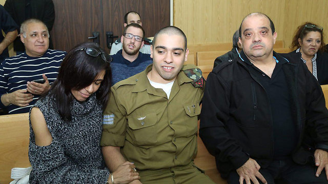 Azaria with his parents in court (Photo: Motti Kimchi)