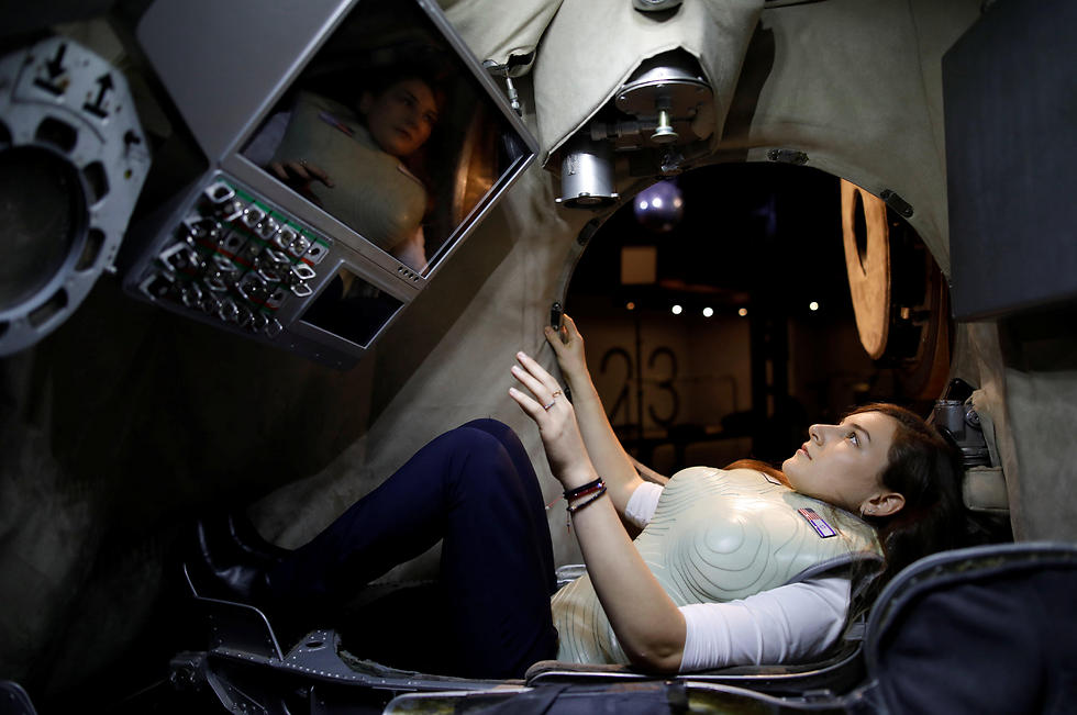 A woman wearing a prototype of Stemrad's new protective vest, Astrorad, sits inside Russian spacecraft, Excalibur-Almaz Space Capsule, during a demonstration for Reuters, at Madatech, National Museum of Science Technology and Space in Haifa (Photo: Reuters)