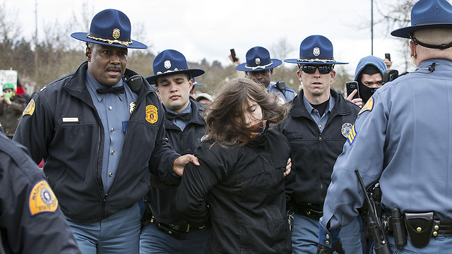 Protester arrested in Olympia (Photo: AFP)