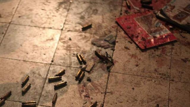Shell cases and blood after the shootout