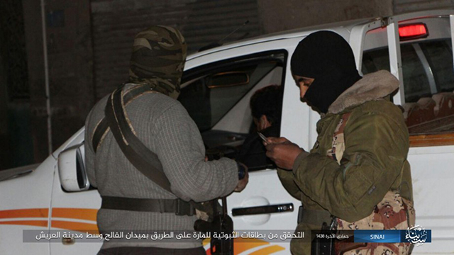 ISIS-SP fighters performing security inspections in Al-Arish