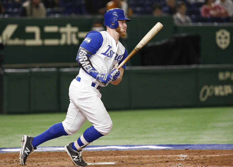 Israel's Zach Borenstein watches the ball while hitting an RBI single against Cuba during the sixth inning (Photo: AP)